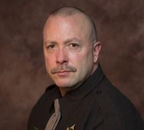 Commander Keith Flores
